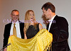 "HEATHER GRAHAM, Simon Peers & Nicholas Godley host the SPIDER SILK EXHIBITION Reception at the AMERICAN MUSEUM OF NATIONAL HISTORY : NEW  YORK-SEPTEMBER 23: HEATHER GRAHAM, Simon Peers & Nicholas Goldey host the SPIDER SILK EXHIBITION Reception  on Wednesday, September 23, 2009 at the American Museum of Natural History (""AMNH""), Grand Gallery, New York City, NY.     Actress Heather Graham unveiled the extraordinary Spider Silk exhibit in the American Museum of Natural History (""AMNH"") at an intimate and private reception honoring Simon Peers and Nicholas Godley, the dreamweavers behind the one of a kind textile made from the silk of more than a million spiders.  A textile woven from the gossamer threads of spiders has long been the stuff of dreams. This Textile is on loan to AMNH from Simon Peers and Nicholas Godley.  Renowned textile artist Simon Peers and fashion entrepreneur Nicolas Godley have taken the impossible from the realm of myth and turned it a unique and fabulous cloth. Drawing inspiration from an eccentric history of attempts to use the silk of spiders in weaving, this unique textile was nearly five years in the making via a painstaking technique that required teams of collectors, 'silkers,' throwers and weavers to produce.  More than a million Golden Orb spiders from Madagascar were collected, ""silked"" (ultra fine, naturally golden-colored silk was carefully extracted by hand from the female spiders' spinnerets) and released.  The result was silk untrammeled, untouched and untreated which then was thrown and mounted on a loom to be woven as pure as the silk in a web.  This spectacular textile encompasses an extraordinary history, embodying the diverse meanings and associations that inspire and fire the imagination, nightmare and phobia with tales and myths that resonate within us all.  Few textiles can claim such a rich heritage.  A sparking gold carpet and bubbly Veuve Clicquot  welcomed guests as they entered the Grand Gallery, washed in muted champagne and gold lights. Donna D'Cruz  spun gossamer for a guest list which included: Waris Ahluwalia, Victoria Aitken, Count ""Calle"" and Countess Natalie von Bismarck, Phillip Bloch, Geoffrey Bradfield, Coralie Charriol, Alina Cho, Alistair and Blair Clarke,  Colin Cowie, Peter Davis, Lydia Fenet, Lucia Hwong-Gordon, Kimberly Guilfoyle, Zelda Kaplan, Anisha Lakhani, Countess LuAnn de Lesseps, vocalist Pamela Luss, Lara Meiland Shaw, Nicole Miller, Mia Morgan, Tinsley Mortimer, Duncan Quinn, Sessa von Richthofen, jewelry designer   Mimi So, Susan Shin, Carlos Souza,  Tracy Stern, Gigi Stone, Antony Todd, Eric Villency, Joel Warren, Arden Wohl,  Daphne Zuniga  and more.   PHOTO CREDIT: ©Manhattan Society.com 2009 by Karen Zieff 